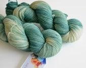Hand Dyed Sock Yarn - Superwash Merino / Nylon 463 Yards - Ent in Pine Green and Cream