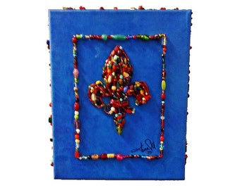 fleur di lis beaded art wall hanging is a symbol for Louisville, New Orleans and France