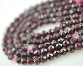 1/2 strands of faceted garnet round beads