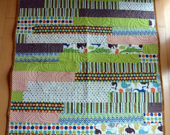 Scrappy Strip Quilt in Blues, Greens, Browns and other bold colors