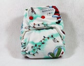 Final Clearance: Small fitted Christmas cloth diaper made with OBV features gingerbread men, Santa Claus, lights and snowmen