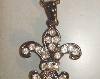 vintage silver necklace with rhinestone fleur de lis pendant