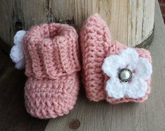 Crochet baby girl boots, in light pink and white flower and pearl button center. size 0 to 3 mo.