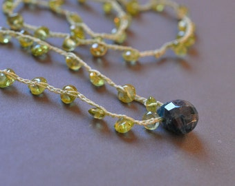 Lime green peridot strand with dark bluegreen pendant crocheted gemstone necklace