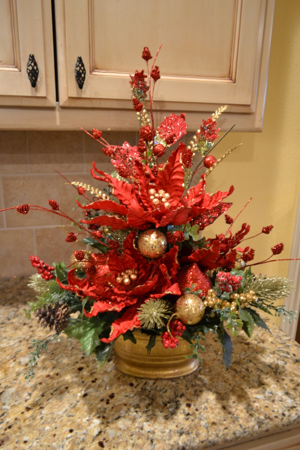Elegant poinsettia arrangement for Poinsettia arrangements
