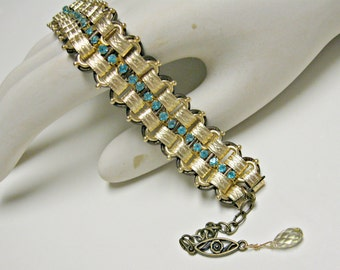 Handmade chain, rhinestone, leather bracelet. Embossed gold over brass, aquamarine crystals, dk bronze leather. Adjustable, one size.