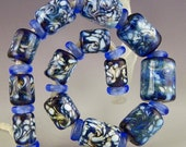 set of 13 graduated cylinders in blue & white swirled handmade lampwork glass beads short tubes - Storm Front
