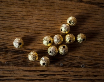 6mm Gold Stardust Round Beads - Qty 25