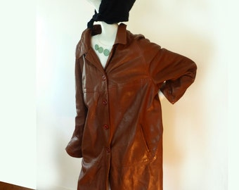 Brown woman's leather coat or jacket, knee length, vintage 70s, loose-fitting, soft in touch, large, made in Canada cool leather winter coat
