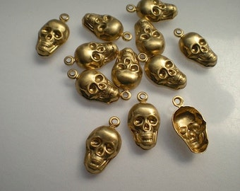 12 brass skull charms