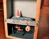 wooden fish and sailboat automaton in small wood box