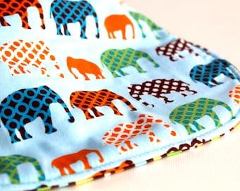 It's the BiBitty - Blue Elephant Parade - A Montessori and Waldorf Inspired Self Feeding Bib