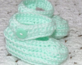 Mint booties with strap and button.
