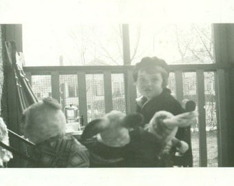 Tea Party Little Girl With Her Stuffed Animals Sitting At Table on Porch 1940 Vintage Black White Photo Photograph