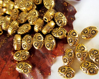 30 Antique gold beads oval embossed tibetan style 8mm 6mm B0408