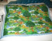 Handmade machine quilted(winnie the pooh and friends in the park) quilt.