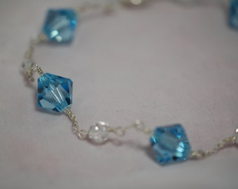 REDUCED from 25.00 Light blue Swarovski crystal & Czech glass bracelet. Sterling silver, wire wrapped, bridal jewelry, something blue.