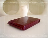 Burgundy Plastic Cigarette Case That Serves Them Through A Side Hole