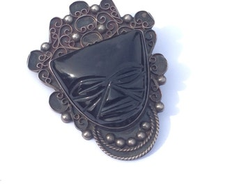 Vintage Mexican sterling pin with black Onyx giant tiki face signed