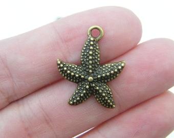 8 Starfish charms antique bronze tone BC100