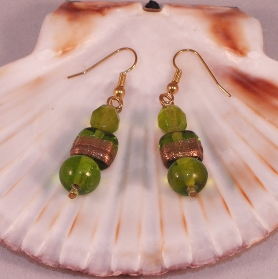 Gold dangle earrings with green Indian glass beads