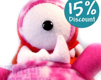 Chrisha Monster Carcolito . a Cool snail monster. Bug plush. red, blues, teal and pinks.