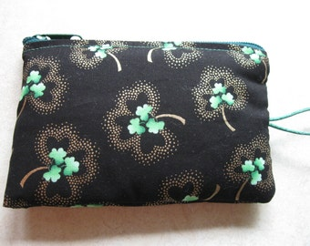 green shamrock with gold padded makeup jewelry bag