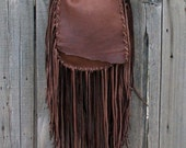 Fringed brown leather crossbody handbag