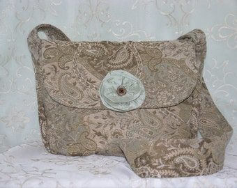 Tapestry messenger bag with silk floret accent