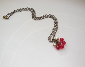 Red, ivory and champagne antique gold beaded cluster pendant necklace