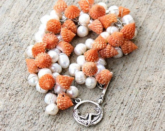 teardrops of the moon / shell bracelet by UniqueNecks /spiritual wire wrapped seashells white pearls / peach integrity psychic jewelry