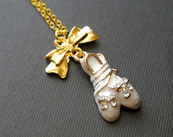 White enamele ballet shoes necklace with gold bow charm