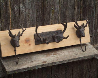 Rustic Cast Iron  Stag heads and Deer Antler coat rack  - lodge cabin decor - rich patina  cast iron hooks and western cedar