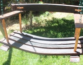 Beautiful porch or patio swing made from reclaimed French and California wine barrels