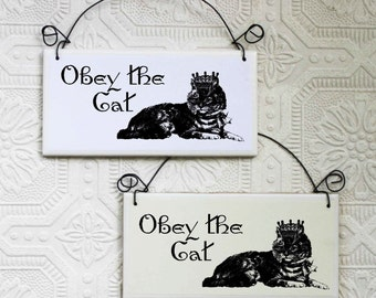 A Warning Sign For Those Owned By a Cat That Says Obey The Cat