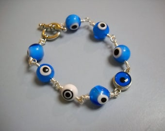 I Got MY EYE On You Blue White and Silver Wire Wrapped Beaded Bracelet