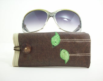 Eyeglass or sunglass case in brown with green birds
