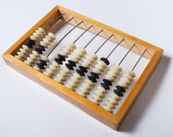 Vintage Russian abacus, wood primitive calculator.