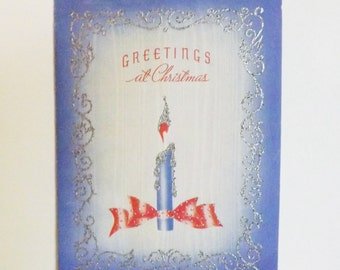 Vintage pastel embossed Christmas Greetings card with blue candle and red bow and silver glitter