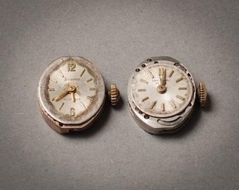 Set of 2 Vintage  Swiss made watch movements, watch parts, watch face.  Accurist and Universal Genewe