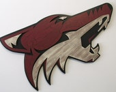 Phoenix Coyotes Logo handcrafted from wood with a custom unique painted finish