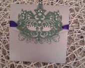 Mardi Gras, Gold  Pocket fold Invitation card, with a Green mask, with purple ribbon and swarovski Crystals