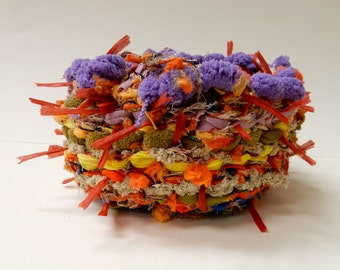 Rag basket made with recycled clothing and novelty yarns
