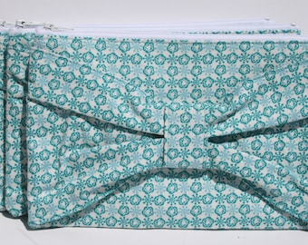 Bow Clutch Teal Cotton Print flowers/snowflakes on a cream background Zipper date evening clutch