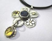 Silver gold flower pendant .