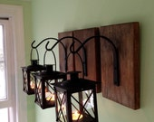3 Black Lanterns With Black Wrought Iron Hooks