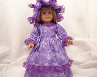 Purple and white print on lavender, long dress for 18 inch dolls, with purple lace trim.
