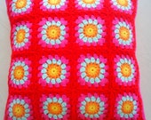 granny square crochet cushion cover in red and pink