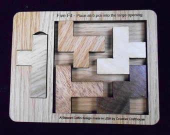 Five Fit Puzzle - Place all pcs in the large opening.  Looks easy, but very tough!