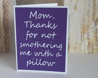 Mum or Mom, thanks for not smothering me with a pillow - Purple card with White lettering - Mothers day inspired - Blank inside